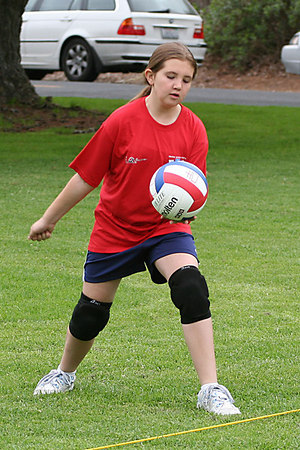 Morgan Dibler serving the ball. US Youth Volleyball League.