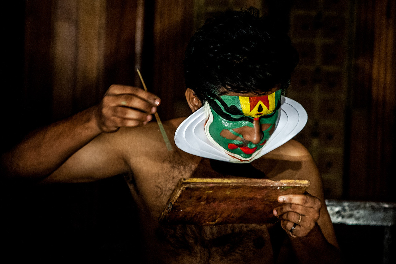 Kathakali artists applying make-up before a show