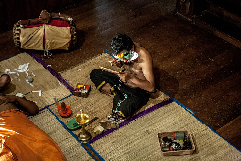 Artist applying make-up before the KAthakali show in Kochi, Kerala