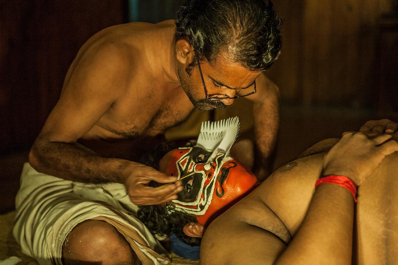 Artist applying make-up before the KAthakali show in Kochi, Kerala