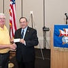 Knights of Columbus district master, Jim Shonefeld presents a check  to Jerry Pierce for the Central Florida Veterans Memorial Park.