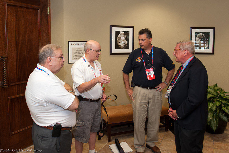 Herb Swoope, Rick Hughes, and Mike Formato discuss procedures with RNC coordinator, Ted Garris