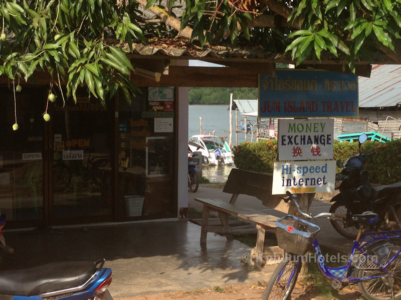 Sign for Money Exchange and high speed internet Baan Koh Jum Village Koh Jum