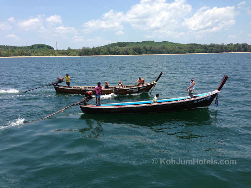 Longtail Boat leaving Koh Jum and joing the Krabi to Koh Lanta Ferry
