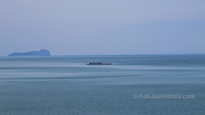 Koh Lanta to Krabi ferry waiting in the middle of the sea so people can join from Koh Jum by longtailboat