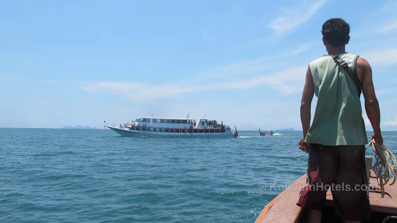 Koh Jum Longtail heading to the ferry to meet guests