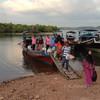 Longtail boat from the mainland pier in Laem Kruat arriving at Koh Jum Mutu pier