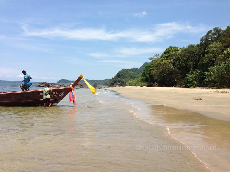 Long Tail Boat departing Ao Si Beach Koh Jum to meet the Krabi to Koh Lanta Ferry