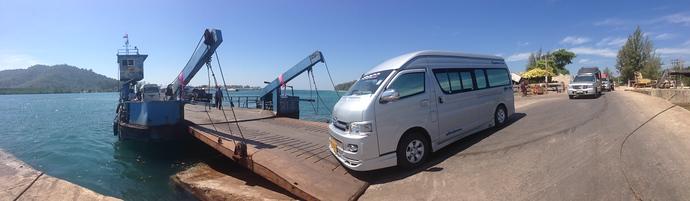 Minivan driving onto the Koh Lanta Car Ferry