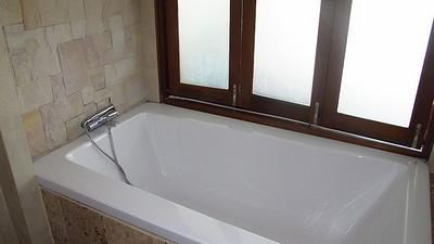 Master Ensuite Bathroom has a bath tub and shower