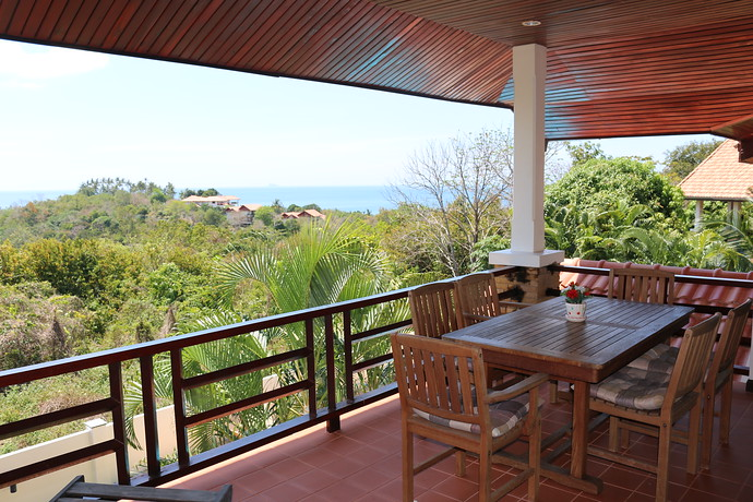Villa Anakira Upper level outside dining area with sea views