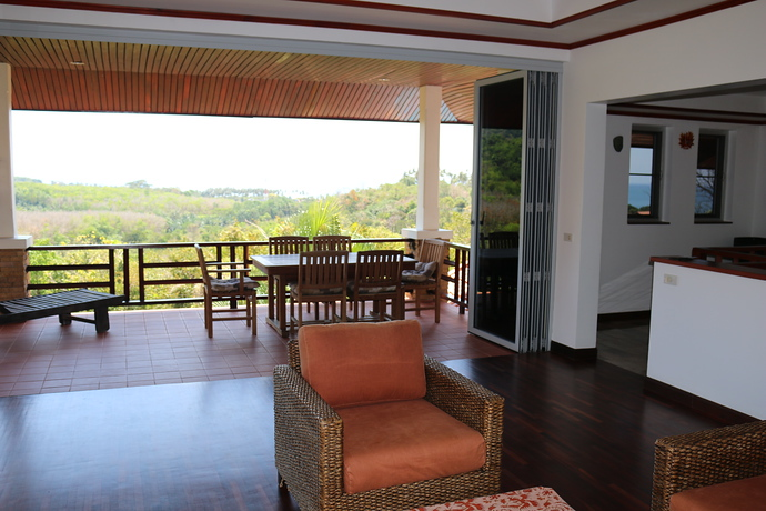 Villa Anakira Floor to ceiling windows allow access to the terrace area