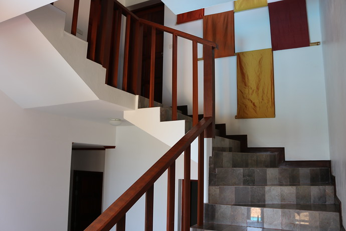 Villa Anakira stairs connecting the lower and upper levels