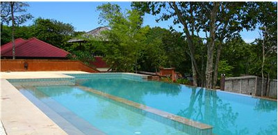 The shared swimming pool is next to Villa Itam