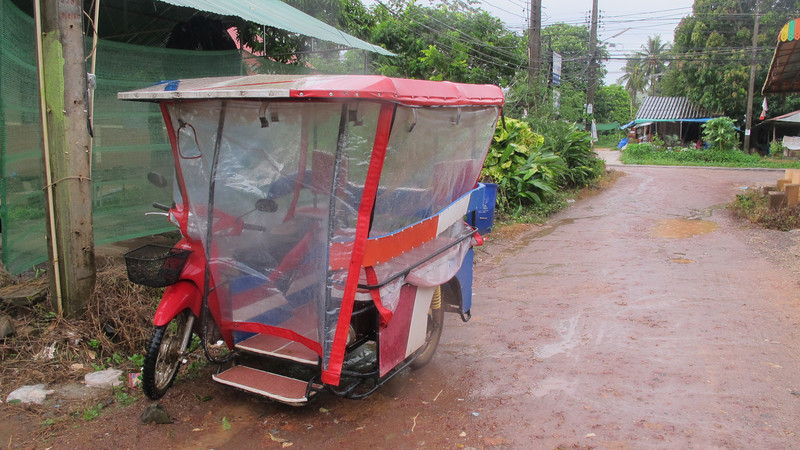 Koh Lanta motorbike taxis are prepared for all weather, so passengers stay dry