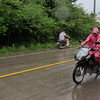A motorbike driver heads home in the rain on Koh Lanta