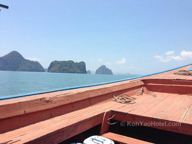 longtail boat ferry traveling from thalane pier krabi to tha khao pier on koh yao noi