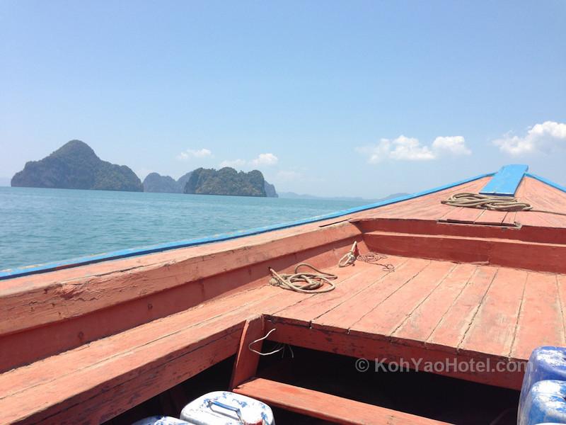 longtail boat ferry traveling from thalane pier krabi to tha khao pier on koh yao noi