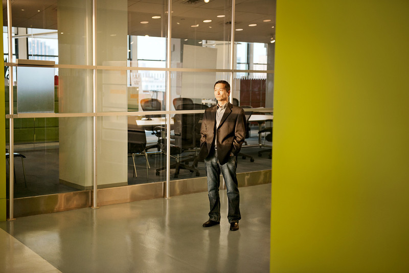 Asian American Man Standing in Corporate Office