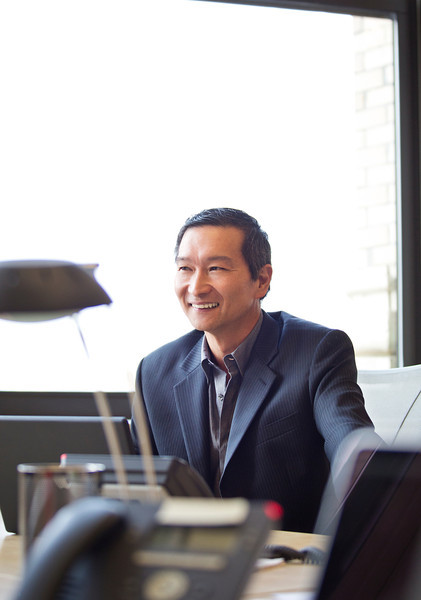 Asian American CEO in his Office