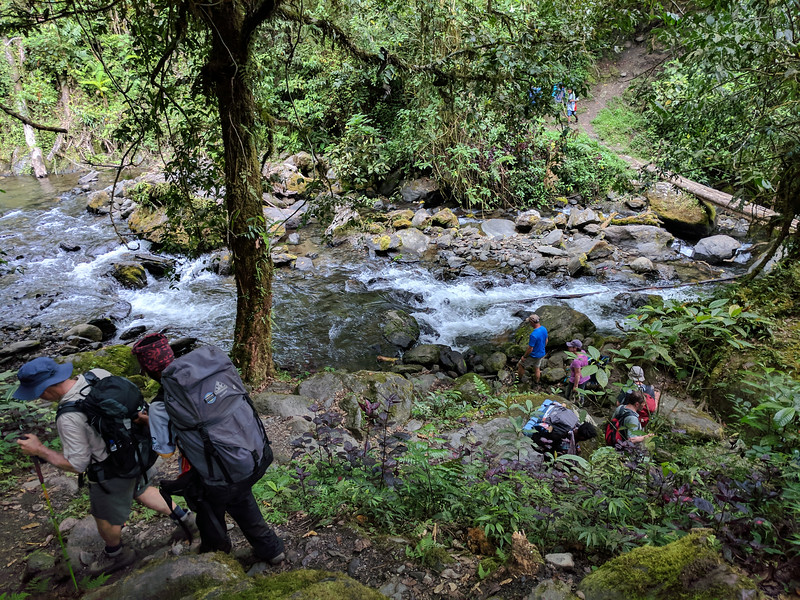 After a very long descent we arrive at the river's edge where the cooks are preparing a hot lunch of ham and noodle rolls - delicious!   I am at my lowest ebb here, the long downward stretch has hit me hard.   Thank goodness for a long rest.
