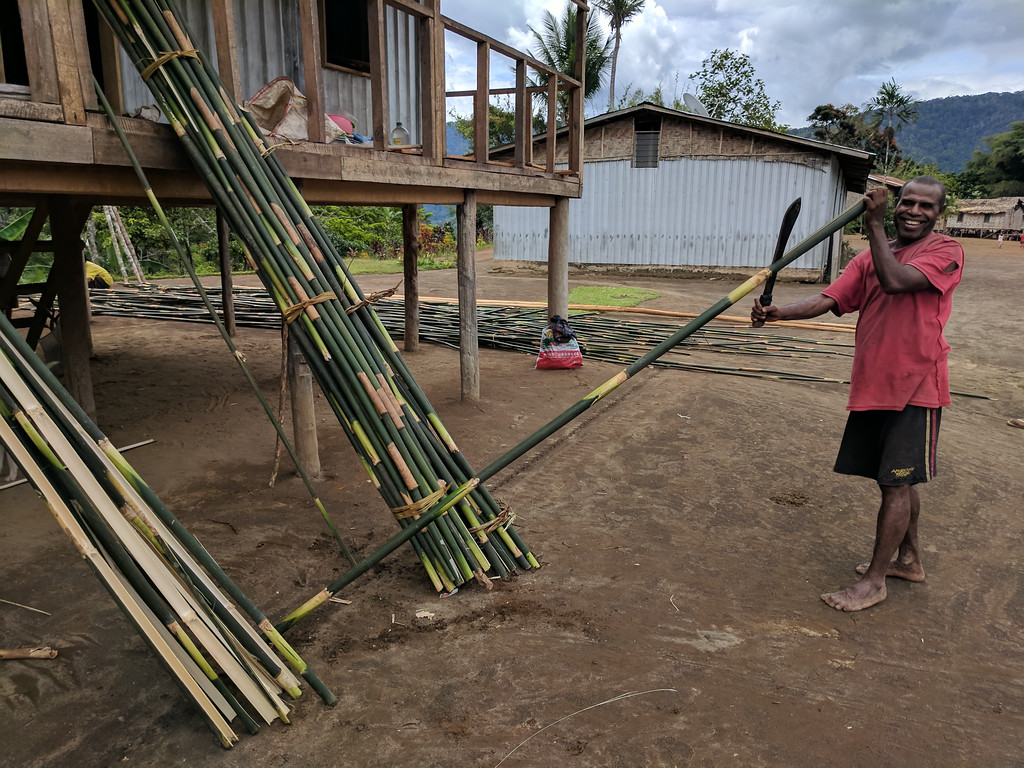 Our happy friend is splitting bamboo for his colleagues to make into floor matting or cladding