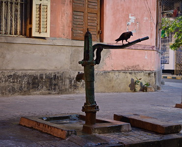 Hand operated well pumps are still present and being used in the suburban streets of Kolkata.