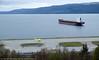 11. mai 2015, rett utenfor Narvik Lufthavn Framnes: KSL San Francisco, 181 066 dwt, 292x45 m, Hongkong-registrert. Ambulansefly utenfor terminalbygning og i ferd med å ta av.