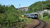 Persontog på vei opp mot Sverige. Passerer Furumoen, bydel i Narvik.