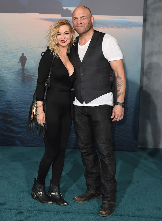 """. Randy Couture, right, and Mindy Robinson arrive at the Los Angeles premiere of \""""Kong: Skull Island\"""" at the Dolby Theatre on Wednesday, March 8, 2017. (Photo by Jordan Strauss/Invision/AP)"""