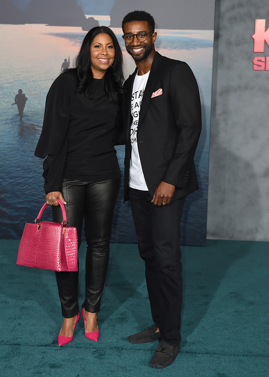 """. Cookie Johnson, left, and her son Andre Johnson arrive at the Los Angeles premiere of \""""Kong: Skull Island\"""" at the Dolby Theatre on Wednesday, March 8, 2017. (Photo by Jordan Strauss/Invision/AP)"""