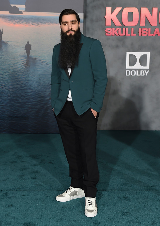 """. Director Jordan Vogt-Roberts arrives at the Los Angeles premiere of \""""Kong: Skull Island\"""" at the Dolby Theatre on Wednesday, March 8, 2017. (Photo by Jordan Strauss/Invision/AP)"""