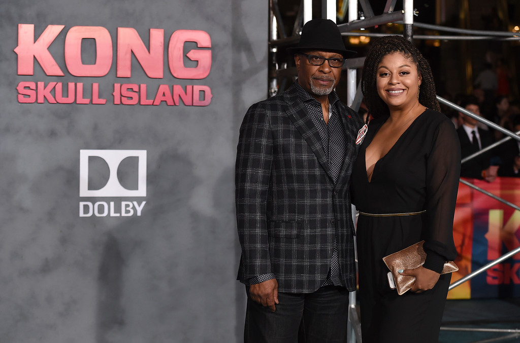 """. James Pickens Jr., left, and his daughter Gavyn Pickens arrive at the Los Angeles premiere of \""""Kong: Skull Island\"""" at the Dolby Theatre on Wednesday, March 8, 2017. (Photo by Jordan Strauss/Invision/AP)"""