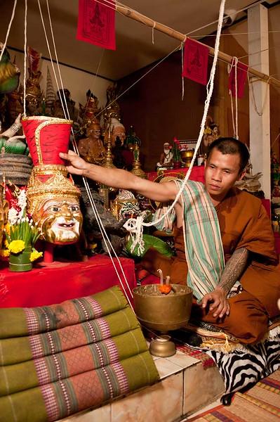 Monk Reaches for A Siarn Ruesi