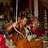 Monk Pulls On the Sai Sin, Sacred Thread, That Connects Him to Devotees
