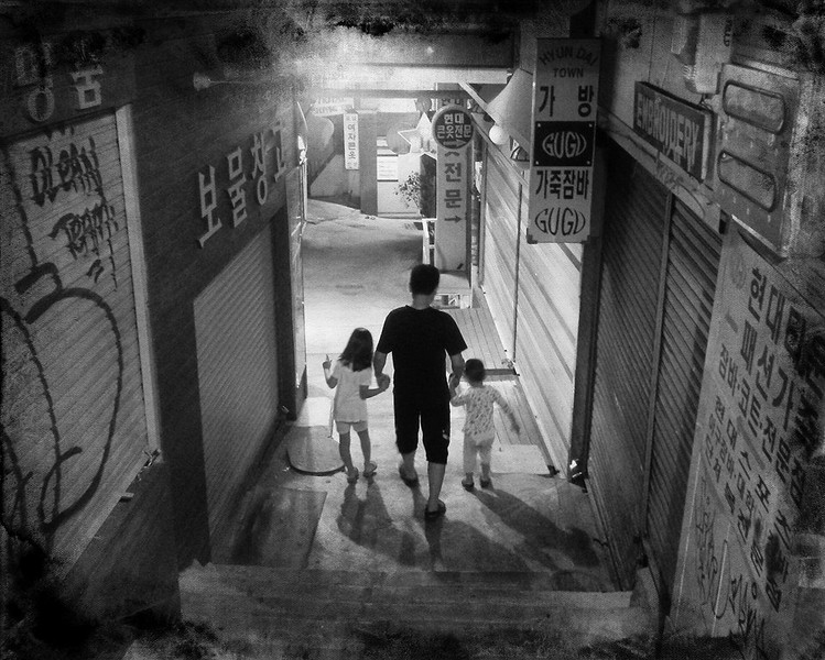 Saw this family taking out the garbage late at night. They posed for a few photos then went back down the alley to home.