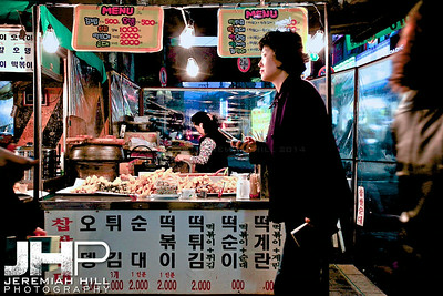Food stall. Everything deep fried you could want. Including squid tentacles. Mmm. Ate a few of them here. Chang-dong Station, Norhern Seoul.  Print KOR3B-1020-157