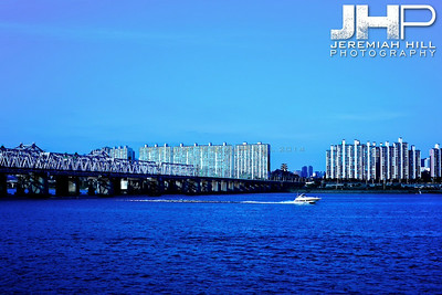 One of the few small boats on the Han river jets East. Print KOR3B-919-161