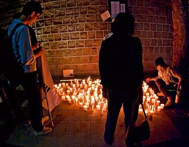 Demonstrators pausing at an ad hoc shrine by Toksugung palace wall.