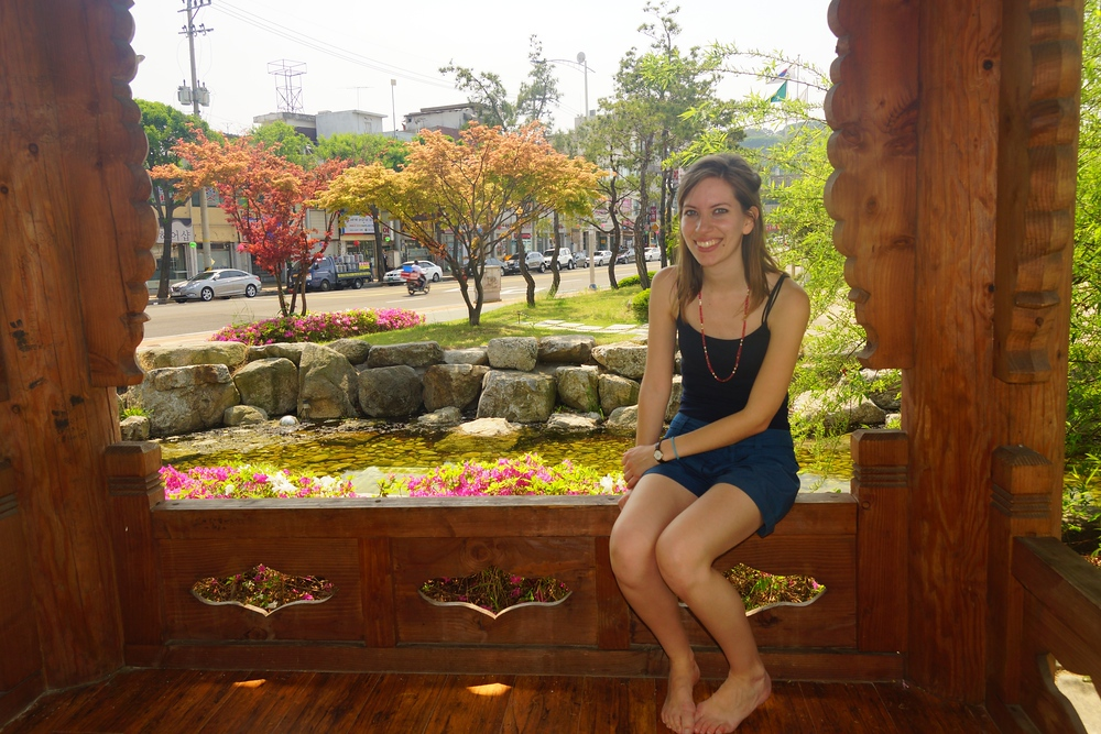 Audrey Bergner (That Backpacker) sitting and relaxing at a pavillion