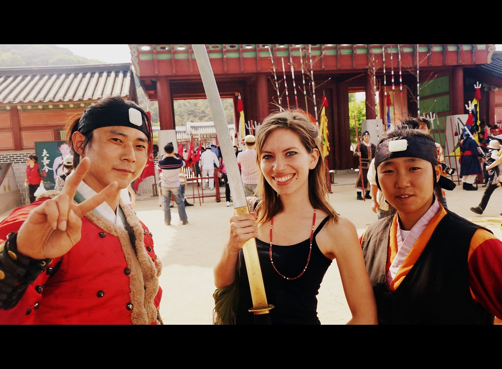 Audrey Bergner (That Backpacker) wielding a sword with some Korean martial artist performers