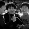 Today's daily photo is of a group of Korean boys exuberantly singing an English song while laughing during an English Pop Song Festival at my Korean school.