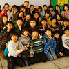 This photo is of one of my final classes teaching in South Korea at a Korean public elementary school where I'm happily posing with all of my students.
