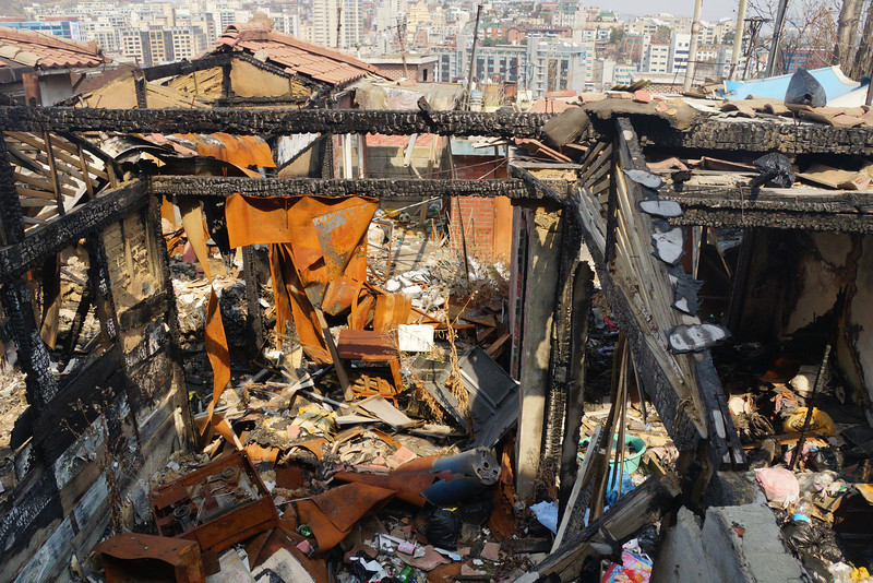 Today's daily travel photo is of a burnt down / condemned section of housing along a tradition area in Hannam - Itaewon overlooking a steep hill in Seoul, Korea.