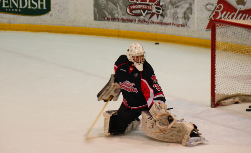 "This is a travel shot of a University of New Brunswick Varsity Reds hockey goalie making a save during a routine warm-up drill in Fredericton, NB, Canada:<br /> <br /> <a href=""http://nomadicsamuel.com/photo-blog/hockey-goalie-making-save-unb-fredericton"">http://nomadicsamuel.com/photo-blog/hockey-goalie-making-save-unb-fredericton</a>"
