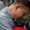 "A Korean man enjoying an intimate encounter with his dog giving it a kiss - Insadong (Seoul), Korea.  Travel photo from Insadong (Seoul), Korea. <a href=""http://nomadicsamuel.com"">http://nomadicsamuel.com</a>"
