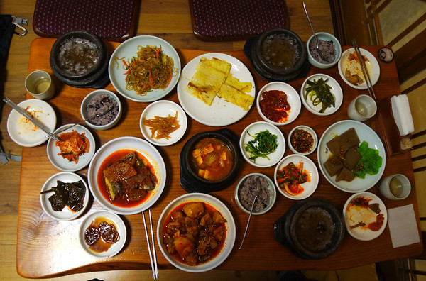 Eating a traditional Korean feast at a sit down on the floor restaurant in Insadong