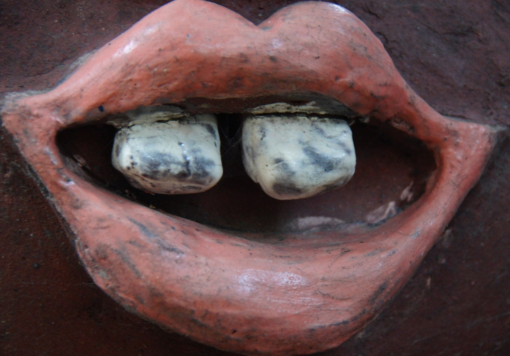 A close-up perspective shoots of the lips and teeth of a sculpture found at the Korean Folk Village - Yongin, South Korea.  Travel photo from Yongin, South Korea.