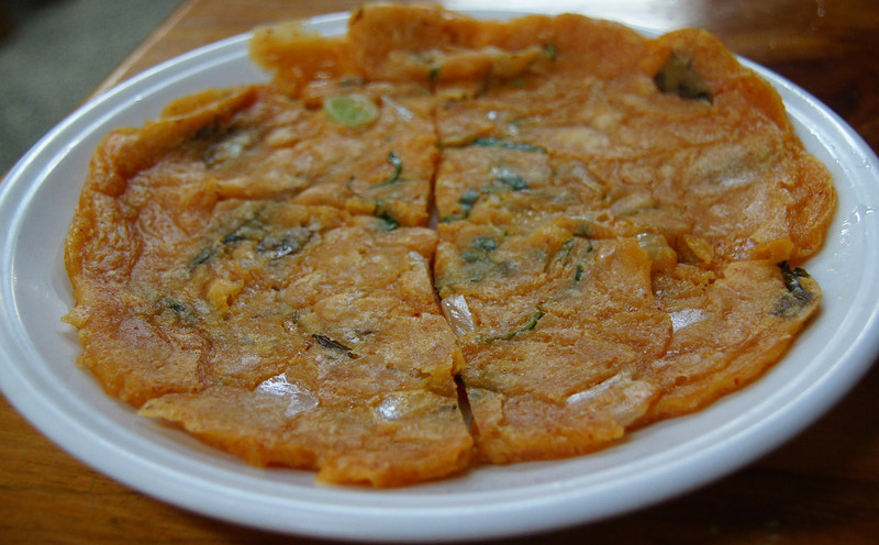 "Korean kimchi pancake served for lunch - Yongin, South Korea.  To view my travel gallery from Korean Folk Village click on the photo. <a href=""http://nomadicsamuel.com"">http://nomadicsamuel.com</a>"