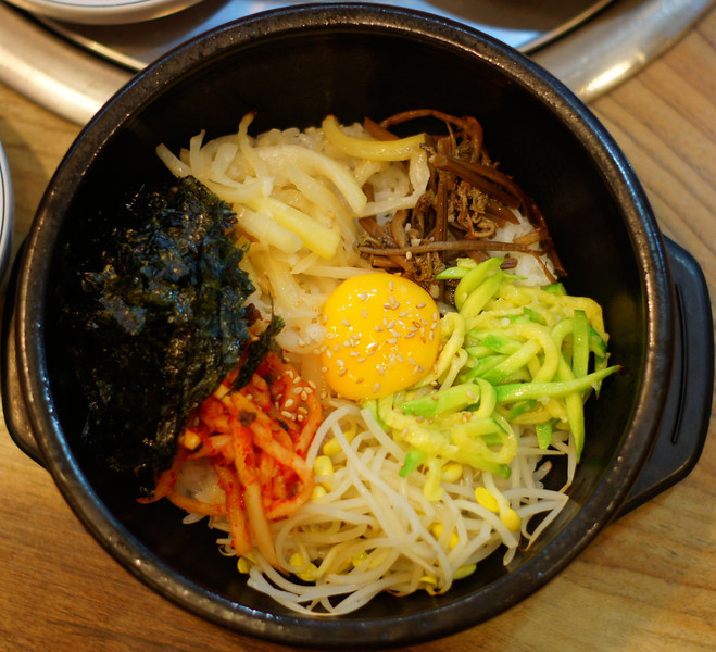 Korean bibimbap (비빔밥) - mixed meal of various vegetables, rice, egg and red pepper paste.